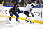 St. Louis Blues center Jaden Schwartz (9) tries to get the puck from Dallas Stars left wing Loui Eriksson (21) in the third period during a game between the Dallas Stars and the St. Louis Blues on Friday April 19, 2013 at the Scottrade Center in downtown St. Louis.  St. Louis won, 2-1.