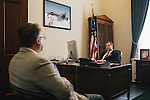 Congressman Jim Bridenstine talks with David Oakley in his office before a conference call in the Cannon House Office Building on Sept. 19, 2013.
