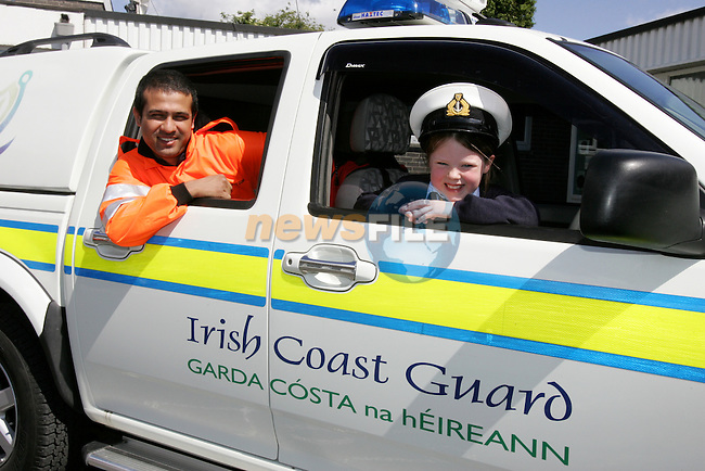 Irish Coast Guard Member Sabash Khanal  with Student  Emily O'Hagan from Slane National School..Photo: Newsfile/Fran Caffrey..The summer is here and the Drogheda Coast Guard Unit are back visiting the local Primary Schools for their Annual Water Safety Talk..This has been a very successful campaign over the last four years; we have educated thousands of children in all aspects of Water Safety form the Louth and Meath Areas..We introduce the children to the basic dangers that they are likely to encounter when visiting the seaside, lakes and rivers. We also teach them the Safe Swimming Guide..We demonstrate the wearing of Lifejackets and Buoyancy Aids, how to get help if the find someone in trouble in the water, at the seaside or near cliffs..We also demonstrate the equipment that the Coast Guard wear and use in different areas of operations..The children are then brought into the schoolyard where we show them one of our Coast Guard Boats and all Life Saving Equipment on board..Last year we visited thirty schools reaching approx. three thousand children..We wish everyone a warm and happy summer..Enjoy our local waterways and coast, always read signs, stay alert and beware of any dangers..If you see any one in difficulty in our local Rivers, Lakes or along our Coast, Call 112 or 999 and ask for the Coast Guard...Dermot Mc Connoran .Area Officer .Drogheda Coast Guard...