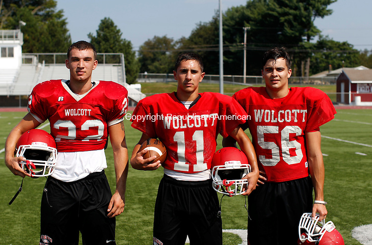 Wolcott, CT- 21 August 2013-082113CM08-  Left to right,  Wolcott football's Joe Lynch, Vince Gambino and Dan Catania during practice Wednesday afternoon in Wolcott.      Christopher Massa Republican-American