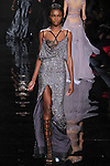 "Model walks runway in a gunmetal sequin dress with Chantilly lace underpinning from the Reem Acra Fall 2016 ""The Secret World of The Femme Fatale"" collection, at NYFW: The Shows Fall 2016, during New York Fashion Week Fall 2016."