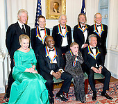 The seven recipients of the 2012 Kennedy Center Honors pose for a photo following a dinner hosted by United States Secretary of State Hillary Rodham Clinton at the U.S. Department of State in Washington, D.C. on Saturday, December 1, 2012.  The 2012 honorees are Buddy Guy, actor Dustin Hoffman, late-night host David Letterman, dancer Natalia Makarova, and the British rock band Led Zeppelin (Robert Plant, Jimmy Page, and John Paul Jones).  From left to right, back row: Former U.S. President Bill Clinton, John Paul Jones, Jimmy Page, Robert Plant, and David Letterman.  From left to right, front row: U.S. Secretary of State Hillary Rodham Clinton, Buddy Guy, Natalia Makarova, and Dustin Hoffman..Credit: Ron Sachs / CNP