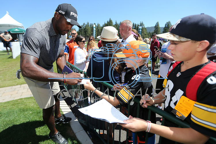 Patrick Peterson, with the Arizona Cardinals, signs autographs between holes during an American Century Championship practice round at Edgewood Tahoe Golf Course in Stateline, Nev., on Wednesday, July 15, 2015. <br /> Photo by Cathleen Allison