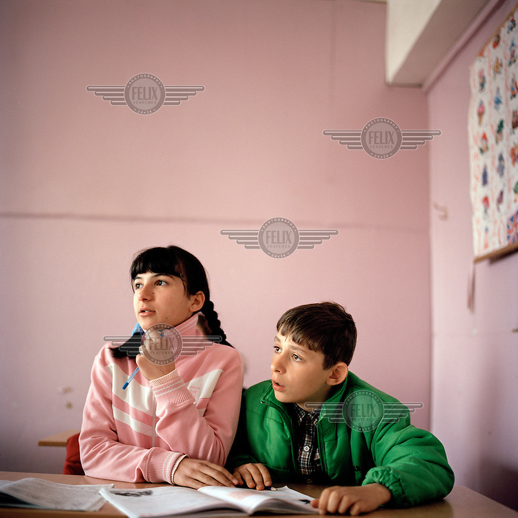 Children during an English language class at one of the two still functioning primary schools in the town of Gali.