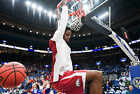 NWA Democrat-Gazette/CHARLIE KAIJO Arkansas Razorbacks guard Daryl Macon (4) hangs from the rim after a dunk during the Southeastern Conference Men's Basketball Tournament quarterfinals, Friday, March 9, 2018 at Scottrade Center in St. Louis, Mo.