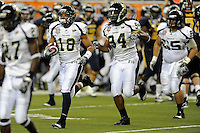 26 December 2010:  FIU cornerback Kreg Brown (18) leads the defense off the field (also pictured, defensive end James Jones (94)) after he intercepted a pass in the fourth quarter as the FIU Golden Panthers defeated the University of Toledo Rockets, 34-32, to win the 2010 Little Caesars Pizza Bowl at Ford Field in Detroit, Michigan.