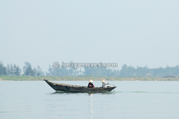 Asia, Vietnam, near Hoi An. Small barge on the Thu Bon river near Hoi An.