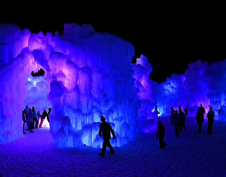 (Lincoln, NH, 02/22/18) People wander through enormous, hand-crafted, 25 million-pound Ice Castles in Lincoln, New Hampshire on Thursday, February 22, 2018. Photo by Christopher Evans