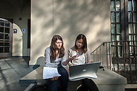 Two female students study on the last day of classes on Dec. 5, 2012 in front of Weingart. (Photo by Marc Campos, Occidental College Photographer)