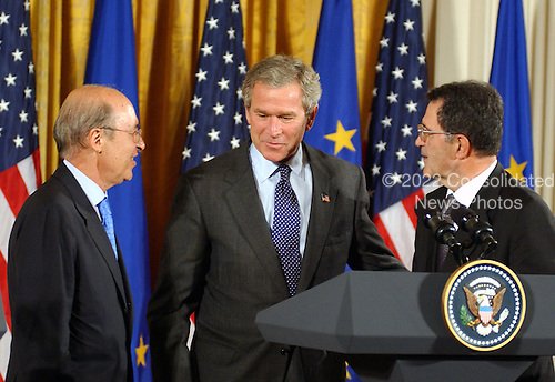 United States President George W. Bush, center,  Prime Minister Constantine Simitis of Greece, Current European Union (EU) President, left, and European Commission President Romano Prodi, right, prepare to depart following a joint press conference in the East Room at the White House in Washington, DC on June 25, 2003..Credit: Ron Sachs / CNP