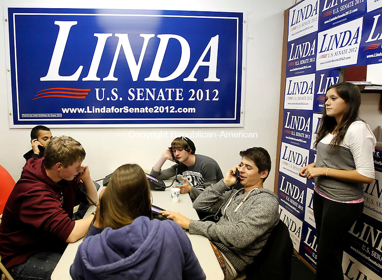 Torrington, CT-04 November 2012-110412CM18-  Teenagers from Torrington High School make phone calls for Republican candidate for U.S. Senate, Linda McMahon, at her headquarters Sunday night in Torrington.  A rally was held by the Torrington Republican Town Committee in support of McMahon.   Christopher Massa Republican-American