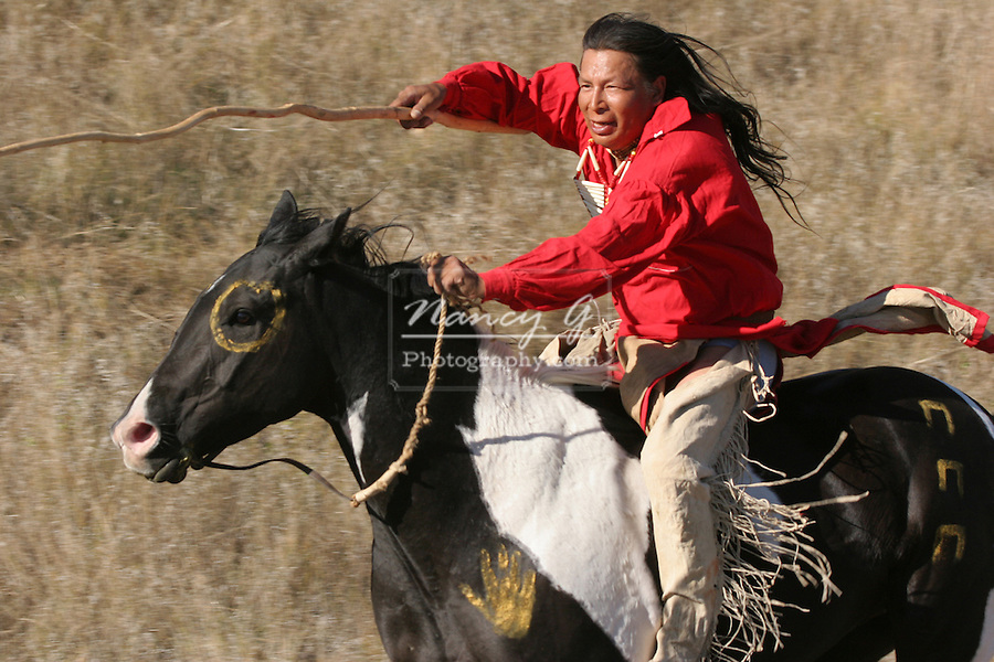 A Native American Sioux Indian man riding horseback on a ...