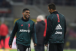 De Oliveira Wesley of Juventus jokes with team mate Danilo in the warm up before the Coppa Italia match at Giuseppe Meazza, Milan. Picture date: 13th February 2020. Picture credit should read: Jonathan Moscrop/Sportimage