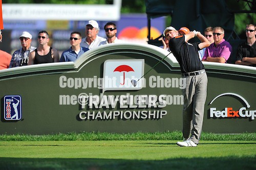 6/28/09 - Photo by John Cheng for Newsport.  Final round of 2009 Travelers Championship takes place at TPC River Highlands in Cromewll, Connecticut.  John Merrick tees off the 18th par 4.