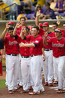 Stony Brook Seawolve bench waits for teammate Kevin Courtney to cross home plate after his home run in the NCAA Super Regional baseball game against LSU on June 9, 2012 at Alex Box Stadium in Baton Rouge, Louisiana. Stony Brook defeated LSU 3-1. (Andrew Woolley/Four Seam Images)