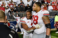 STATE COLLEGE, PA - SEPTEMBER 29: Ohio State RB J.K. Dobbins (2) hugs and celebrates with G Demetrius Knox (78). The Ohio State Buckeyes defeated the Penn State Nittany Lions 27-26 on September 29, 2018 at Beaver Stadium in State College, PA. (Photo by Randy Litzinger/Icon Sportswire)