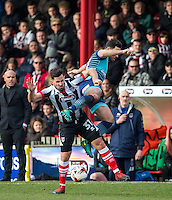Chris Clements of Grimsby Town battles Sam Wood of Wycombe Wanderers during the Sky Bet League 2 match between Grimsby Town and Wycombe Wanderers at Blundell Park, Cleethorpes, England on 4 March 2017. Photo by Andy Rowland / PRiME Media Images.