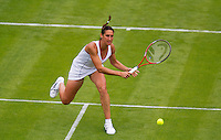 24-06-13, England, London,  AELTC, Wimbledon, Tennis, Wimbledon 2013, Day one, Virginie Rozzano (FRA)<br /> <br /> <br /> <br /> Photo: Henk Koster