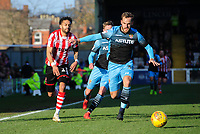Lincoln City's Bruno Andrade vies for possession with Stevenage's Luke Wilkinson<br /> <br /> Photographer Chris Vaughan/CameraSport<br /> <br /> The EFL Sky Bet League Two - Lincoln City v Stevenage - Saturday 16th February 2019 - Sincil Bank - Lincoln<br /> <br /> World Copyright © 2019 CameraSport. All rights reserved. 43 Linden Ave. Countesthorpe. Leicester. England. LE8 5PG - Tel: +44 (0) 116 277 4147 - admin@camerasport.com - www.camerasport.com