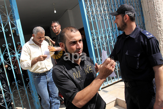 "Palestinian prisoners prepare to be freed from a Hamas-run jail in Gaza City on June 25, 2011. Palestinian Hamas policemen released 26 prisoners in the presence of the convoy of ""Miles of Smiles 3"". Photo by Mohammed Asad"