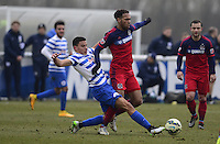 Reece Greg-Cox of QPR tackles Matthew Watson of Chicago Fire