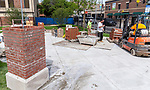 Mason workers lay bricks for a gateway arch Monday, June 25, 2018, at the southwest corner of Fullerton and Halsted, outside of the School of Music building on DePaul's Lincoln Park Campus. (DePaul University/Jeff Carrion)