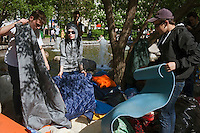 Moscow, Russia, 15/05/2012..Protesters pack up bedding in Chistiye Prudy, or Clean Ponds, as a Moscow court ordered the eviction of some 200 opposition activists who have set up camp in the city centre park.