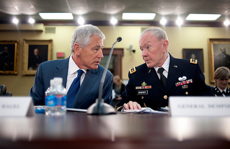 "UNITED STATES - APRIL 16: Defense Secretary Chuck Hagel; and Chairman of the Joint Chiefs of Staff Gen. Martin Dempsey speak before a House Appropriations Defense Subcommittee hearing on ""FY2014 Department of Defense Budget Overview."" (Photo By Chris Maddaloni/CQ Roll Call)"