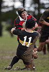 R. Smith is taken in a tackle by A. Ah Sui. Counties Manukau Premier 2 Championship game between Bombay and Papakura played at Bombay on May 13th, 2006. Papakura won 8 - 7.