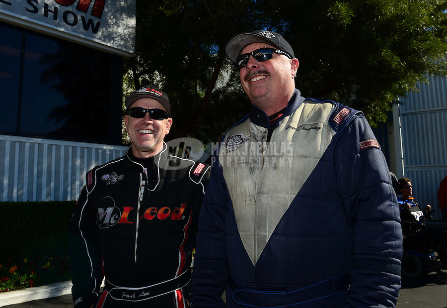 Nov. 11, 2012; Pomona, CA, USA: NHRA funny car driver Paul Lee (left) with Grant Downing during the Auto Club Finals at at Auto Club Raceway at Pomona. Mandatory Credit: Mark J. Rebilas-