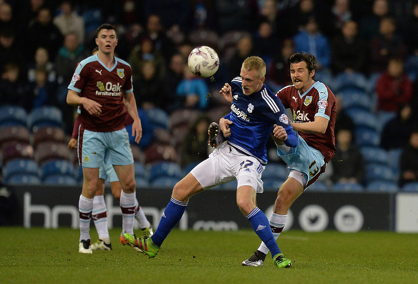 Burnley's Joey Barton battles with Cardiff City's Lex Immers<br /> <br /> Photographer Dave Howarth/CameraSport<br /> <br /> Football - The Football League Sky Bet Championship - Burnley v Cardiff City  - Tuesday 5th April 2016 - Turf Moor - Burnley <br /> <br /> &copy; CameraSport - 43 Linden Ave. Countesthorpe. Leicester. England. LE8 5PG - Tel: +44 (0) 116 277 4147 - admin@camerasport.com - www.camerasport.com