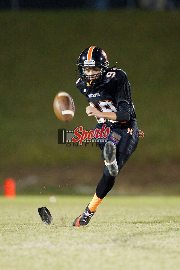 Logan Wagner (99) of the Northwest Cabarrus Trojans attempts a squib kick during first half action against the East Rowan Mustangs at Trojan Stadium October 11, 2013, in Concord, North Carolina.  The Mustangs defeated the Trojans 42-14.  (Brian Westerholt/Sports On Film)