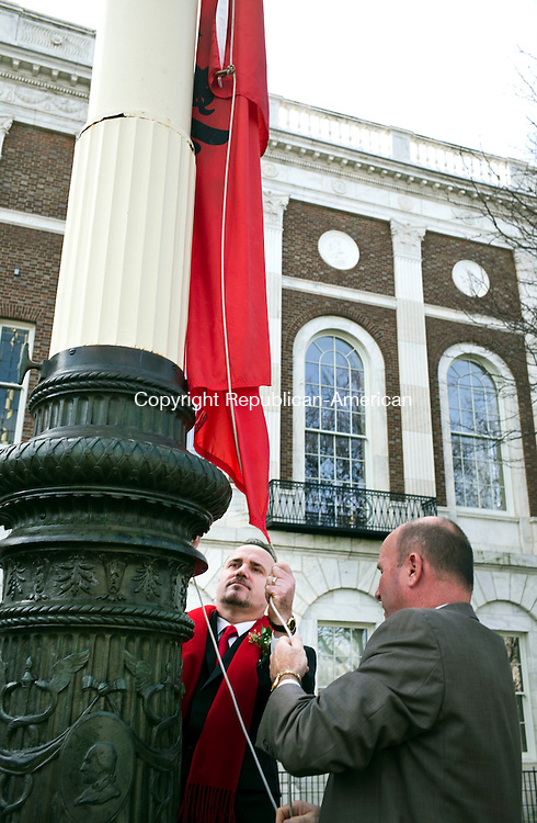 Waterbury, CT- 27 November 2015-112715CM03-  Waterbury Albanian Mayor of the Day Xhemal Dani, left and Joe Geary, City of Waterbury Chief of Staff raise the Albanian flag during the annual Mayor for the Day ceremony at the Waterbury City Hall on Friday. The ceremony honored Xhemal Dani, who was born in Dollogozhda, Macedonia and migrated to Waterbury in 1999. Dani is an active member of the Albanian American Cultural Islamic Center Hasan Prishtina, and has helped develop new programs for youth including schools in Albanian language and dance. Dani also helped organize the Labor Day Weekend Albanian Festival.     Christopher Massa Republican-American