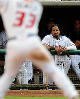 Jun. 23, 2009; Albuquerque, NM, USA; Albuquerque Isotopes outfielder Manny Ramirez watches from the dugout in the fourth inning against the Nashville Sounds at Isotopes Stadium. Ramirez is playing in the minor leagues while suspended for violating major league baseballs drug policy. Mandatory Credit: Mark J. Rebilas-