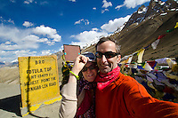 Self portrait of two western travelers at Fotu La the highest point of the Srinagar to Leh road, 13,479 ft. Kasmir/Ladakh, India.