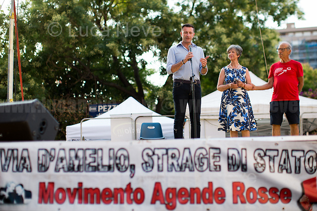 """Gianluca & Angela Manca - Relatives of Urologist Attilio Manca, victim of Cosa nostra mafia but still classified as """"suicide"""", http://www.attiliomanca.it/wp2/ .<br /> <br /> Palermo (Sicily - Italy), 19/07/2017. """"Basta depistaggi e omertà di Stato!"""" (""""Stop disinformation & omertá by the State!"""")(1). Public event to commemorate the 25th Anniversary of the assassination of the anti-mafia Magistrate Paolo Borsellino along with five of his police """"scorta"""" (Escorts from the special branch of the Italian police force who protect Judges): Agostino Catalano, Emanuela Loi (The first Italian female member of the police special branch and the first woman of this branch to be killed on duty), Vincenzo Li Muli, Walter Eddie Cosina and Claudio Traina. The event was held at Via D'Amelio, the road where Borsellino was killed. Family members of mafia victims, amongst others, made speeches about their dramatic experiences, mafia violence and unpunished crimes, State cover-ups, silence ('omertá'), and misinformation. Speakers included, amongst others, Vincenzo Agostino & Augusta Schiera, Salvatore & Cristina Catalano, Graziella Accetta, Massimo Sole, Paola Caccia, Luciano Traina, Angela Manca, Stefano Mormile, Ferdinando Imposimato, Judge Nino Di Matteo. The event ended with the screening of the RAI docu-fiction, 'Adesso Tocca A Me' ('Now it's My Turn' - Watch it here: http://bit.ly/2w3WJUX ).<br /> <br /> For more info & a video of the event please click here: http://bit.ly/2eQfNT3 & http://bit.ly/2eQbmrj & http://19luglio1992.com & http://bit.ly/2he8hCj<br /> <br /> (1) 'Omerta' is the term used in Italy to refer to the code of silence used by mafia organisations, as well as the culture of silence that is entrenched in society at large (especially among victims of mafia crimes, as they fear recriminations), about the existence of organised crime and its activities."""