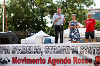 Gianluca &amp; Angela Manca - Relatives of Urologist Attilio Manca, victim of Cosa nostra mafia but still classified as &ldquo;suicide&rdquo;, http://www.attiliomanca.it/wp2/ .<br /> <br /> Palermo (Sicily - Italy), 19/07/2017. &quot;Basta depistaggi e omert&agrave; di Stato!&quot; (&quot;Stop disinformation &amp; omert&aacute; by the State!&quot;)(1). Public event to commemorate the 25th Anniversary of the assassination of the anti-mafia Magistrate Paolo Borsellino along with five of his police &ldquo;scorta&rdquo; (Escorts from the special branch of the Italian police force who protect Judges): Agostino Catalano, Emanuela Loi (The first Italian female member of the police special branch and the first woman of this branch to be killed on duty), Vincenzo Li Muli, Walter Eddie Cosina and Claudio Traina. The event was held at Via D'Amelio, the road where Borsellino was killed. Family members of mafia victims, amongst others, made speeches about their dramatic experiences, mafia violence and unpunished crimes, State cover-ups, silence ('omert&aacute;'), and misinformation. Speakers included, amongst others, Vincenzo Agostino &amp; Augusta Schiera, Salvatore &amp; Cristina Catalano, Graziella Accetta, Massimo Sole, Paola Caccia, Luciano Traina, Angela Manca, Stefano Mormile, Ferdinando Imposimato, Judge Nino Di Matteo. The event ended with the screening of the RAI docu-fiction, 'Adesso Tocca A Me' ('Now it's My Turn' - Watch it here: http://bit.ly/2w3WJUX ).<br /> <br /> For more info &amp; a video of the event please click here: http://bit.ly/2eQfNT3 &amp; http://bit.ly/2eQbmrj &amp; http://19luglio1992.com &amp; http://bit.ly/2he8hCj<br /> <br /> (1) 'Omerta' is the term used in Italy to refer to the code of silence used by mafia organisations, as well as the culture of silence that is entrenched in society at large (especially among victims of mafia crimes, as they fear recriminations), about the existence of organised crime and its activities.