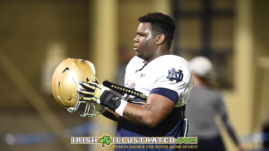 Defensive lineman Micah Dew-Treadway (97)