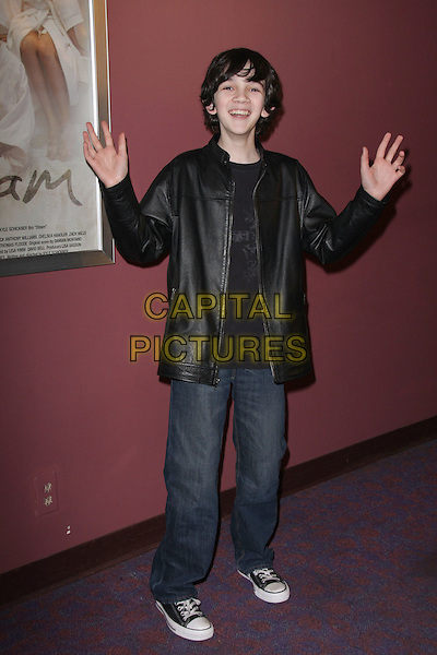 """ZACH MILLS.""""Steam"""" - Los Angeles Premiere - Arrivals held at Laemmle's Sunset 5, West Hollywood, California, USA, .13 March 2009..full length hands gesture converse trainers jeans black leather jacket .CAP/ADM/KB.©Kevan Brooks/Admedia/Capital PIctures"""