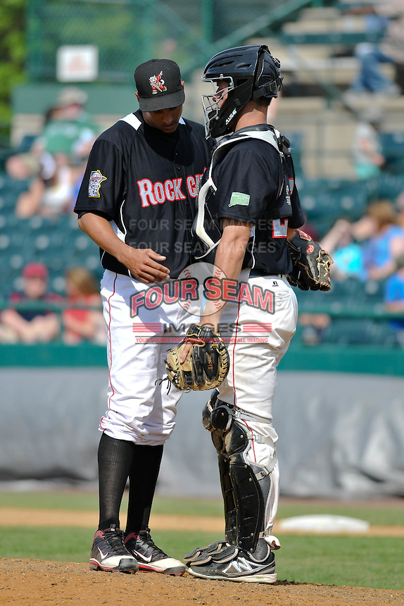 Adrian Salcedo (30) and Matt Koch (22) of the New Britain Rock Cats talk on the mound during a game against the Binghamton Mets at New Britain Stadium on June 1, 2014 in New Britain, Connecticut.  New Britain defeated Binghamton 6-1.  (Gregory Vasil/Four Seam Images)