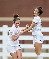 NWA Democrat-Gazette/BEN GOFF @NWABENGOFF<br /> Sydney Wagner (left) congratulates Bentonville teammate Angelina Diaz after Diaz scored the first goal vs Springdale Har-Ber Tuesday, March 12, 2019, during the match at Wildcat Stadium in Springdale.