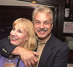 Karen Stabile and Joe Dombroski posing at a gathering on October 13, 2000. Photo by Jim Peppler.