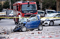 Rome, Italy. 22th January 2016<br /> Car destroyed during the appartment building that collapsed . People were evacuated after a resident heard strange noises and raised the alarm before the building collapsed. There is no victims and an investigation is under way.
