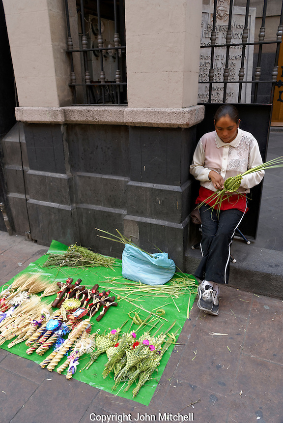 Young Mexican woman weaving religious decorations for Palm Sunday and Easter, Mexico City