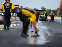 Aug 30, 2019; Clermont, IN, USA; Members of the NHRA Safety Safari work to clean up oil from the car of top alcohol dragster driver Chris Demke during qualifying for the US Nationals at Lucas Oil Raceway. Mandatory Credit: Mark J. Rebilas-USA TODAY Sports