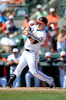 Baltimore Orioles outfielder Nate McLouth #9 at bat during a Spring Training game against the New York Mets at Ed Smith Stadium on March 30, 2013 in Sarasota, Florida.  (Mike Janes/Four Seam Images)