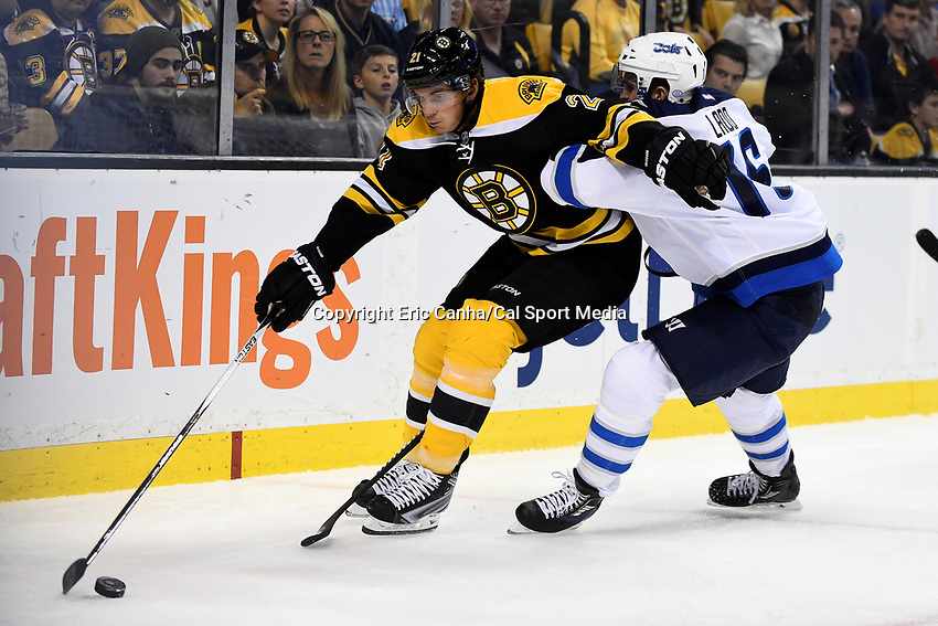 Thursday, October 8, 2015: Boston Bruins left wing Loui Eriksson (21) fights off Winnipeg Jets left wing Andrew Ladd (16) for the puck during the NHL game between the Winnipeg Jets and the Boston Bruins held at TD Garden, in Boston, Massachusetts. Winnipeg defeated Boston 6-2 in regulation time. Eric Canha/CSM