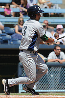 Lexington Legends Jiovanni Mier #3 swings at a pitch during a game against  the Asheville Tourists at McCormick Field in Asheville,  North Carolina;  April 17, 2011. Lexington defeated Aheville 18-9.  Photo By Tony Farlow/Four Seam Images