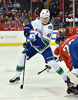 WASHINGTON, DC - FEBRUARY 05: Vancouver Canucks center Elias Pettersson (40) passes back to his defenseman on a face-off during the Vancouver Canucks vs. the Washington Capitals NHL game at Capital One Arena in Washington, D.C.. (Photo by Randy Litzinger/Icon Sportswire)