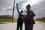 "(L-r) Victoria Carr, 19, a resident of the Lower Ninth Ward section of New Orleans who chose to return and rebuild indicates her home up the road, talks to Mildred Shepherd, 68, of Glencoe, Ill. on March 10, 2008.  The group of ""voluntourists"" from Glencoe, Illinois is traveling to New Orleans to combine traditional tourism with volunteer work in the aftermath of the devastation wrought by Hurrica Katrina in 2005."